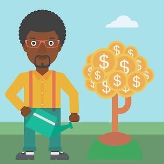 Albero dei soldi d'innaffiatura dell'uomo