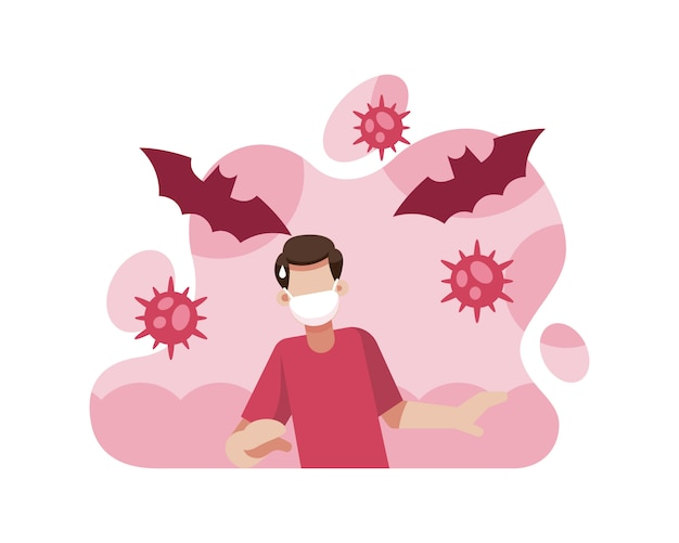 Un uomo indossa una maschera per proteggersi dalla trasmissione del coronavirus dai pipistrelli
