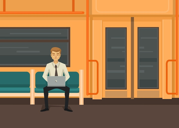 Uomo con il computer in treno