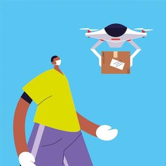 L'uomo con il drone porta una scatola di cartone