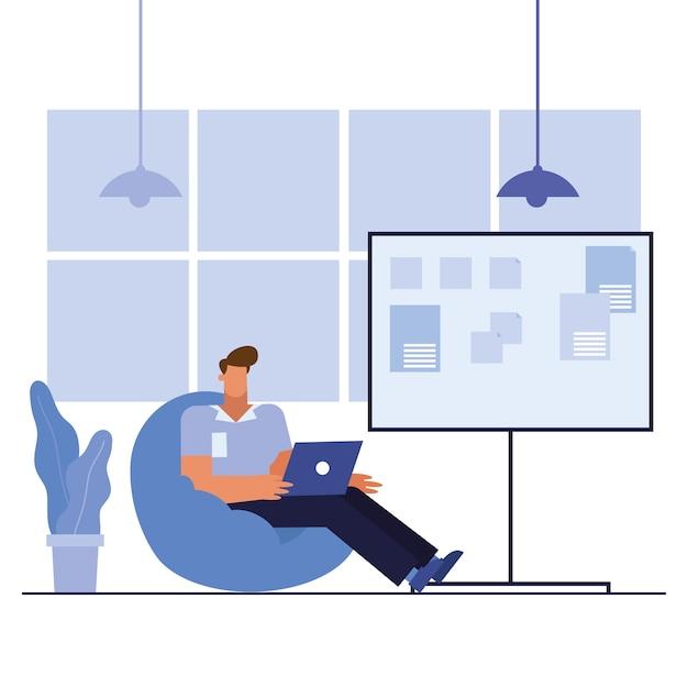 Uomo con il computer portatile nel design dell'ufficio, forza lavoro di oggetti aziendali e tema aziendale