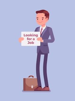 Uomo con alla ricerca di un segno di annuncio di lavoro