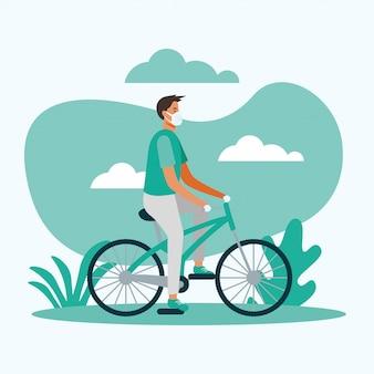 Uomo con mascherina medica sulla bici