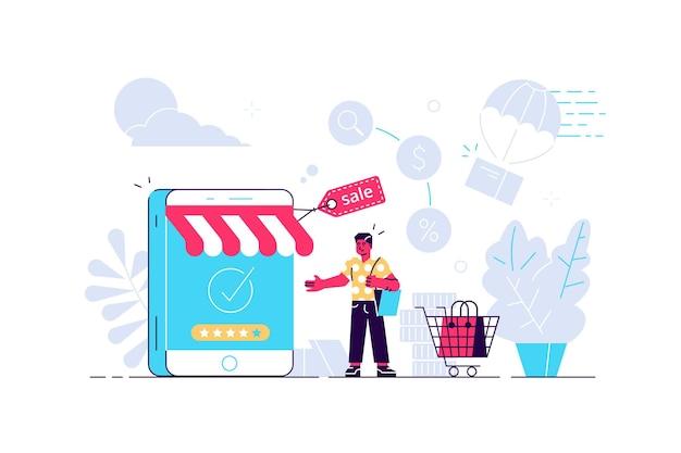 Uomo con modello di smartphone a forma di negozio e carrello della spesa