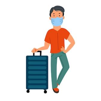 Un uomo con una valigia in maschera sta aspettando il suo trasporto su un aereo
