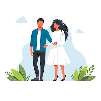 Un uomo e una donna sono in piedi insieme abbracciati giovani coppie romantiche ad una data. la donna, l'uomo sono innamorati. famiglia di marito e moglie. coccole di coppia. felice l'uomo e la donna in piedi insieme avendo.vector