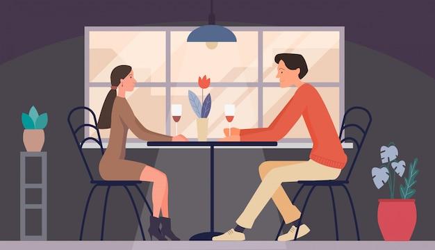 Uomo e donna alla data nel ristorante. incontro coppia d'amore