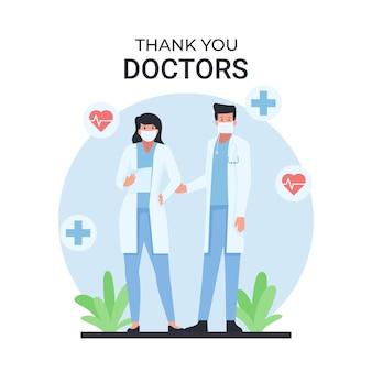 L'uomo e la donna dottore stanno con un testo di ringraziamento