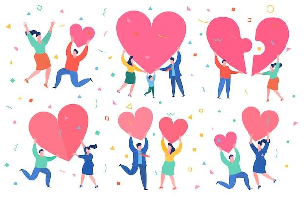 L'uomo e la donna tengono il grande cuore rosso. giorno di valenina. amore e relazione