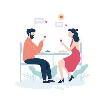 Uomo e donna nel ristorante all'appuntamento romantico