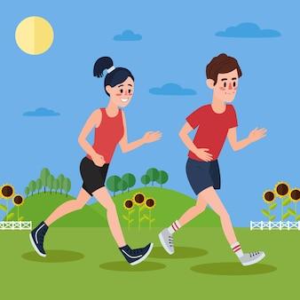 Uomo e donna che corrono nelle colline e nei girasoli
