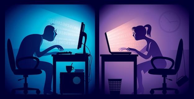 Uomo e donna seduti davanti agli schermi in una stanza buia dell'ufficio