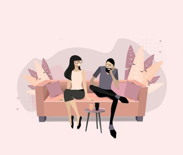 Uomo e donna che si siedono sul sofà bianco e che bevono caffè. persone nella sala di ricevimento sul comodo divano con bevande calde