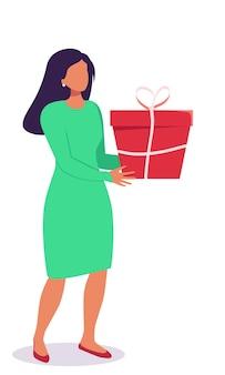 Uomo e donna con una confezione regalo in mano con un grande cuore