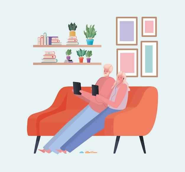 Uomo e donna con tavoletta lavorando sul design divano arancione del tema del lavoro da casa