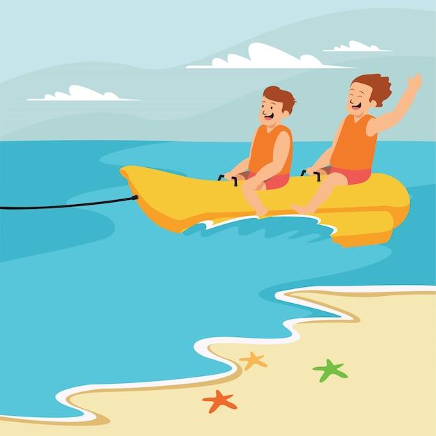 Gli uomini stanno cavalcando una banana boat insieme in spiaggia