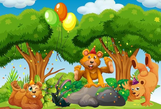 Molti orsi in tema di festa nella foresta naturale