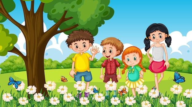 Molti bambini in piedi nel giardino fiorito