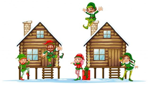 Molti elfi sulle capanne di legno