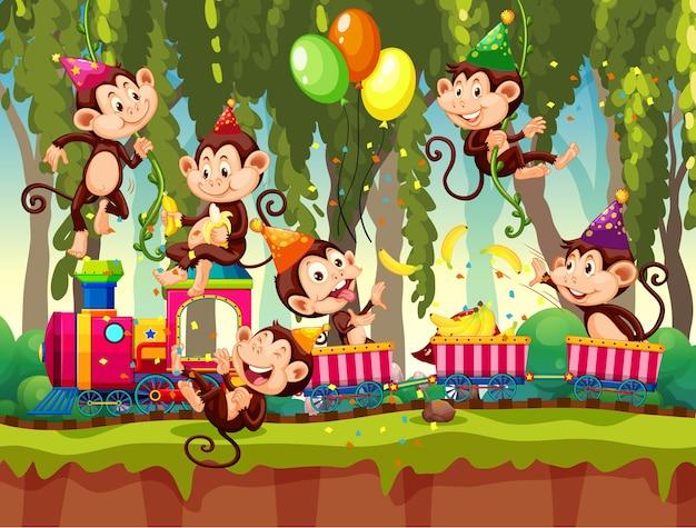 Molte scimmie in tema di festa sullo sfondo della foresta di natura