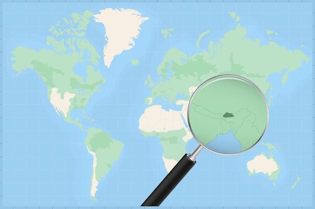 Mappa del mondo con una lente di ingrandimento su una mappa del bhutan.