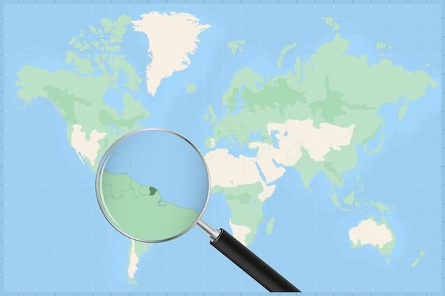 Mappa del mondo con una lente di ingrandimento su una mappa della guyana francese.