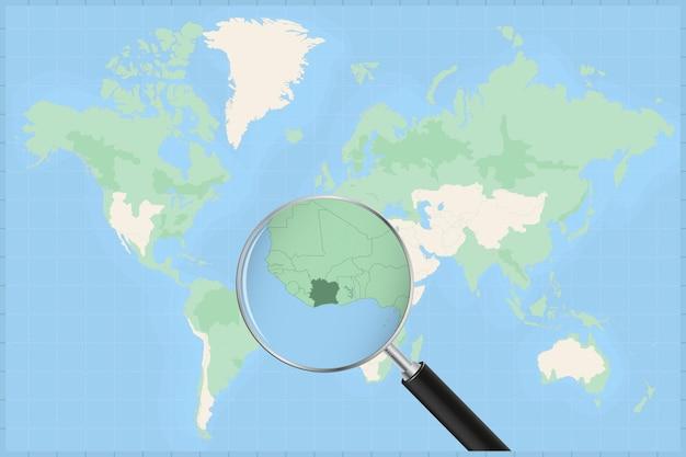 Mappa del mondo con una lente di ingrandimento su una mappa della costa d'avorio.
