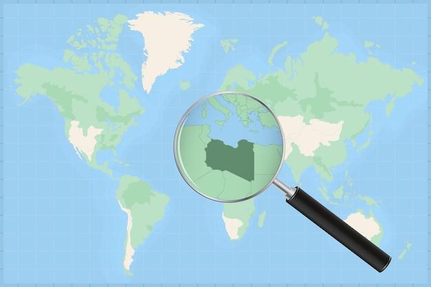 Mappa del mondo con una lente di ingrandimento su una mappa della libia.