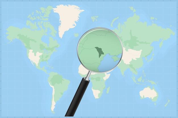 Mappa del mondo con una lente di ingrandimento su una mappa della moldavia.