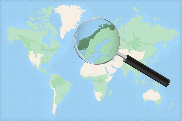 Mappa del mondo con una lente di ingrandimento su una mappa della norvegia. Vettore Premium