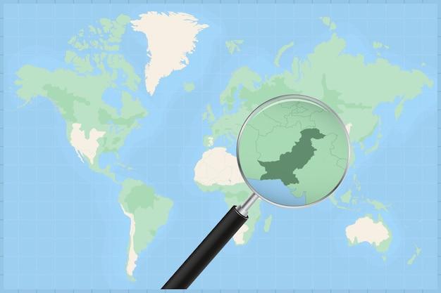 Mappa del mondo con una lente di ingrandimento su una mappa del pakistan.