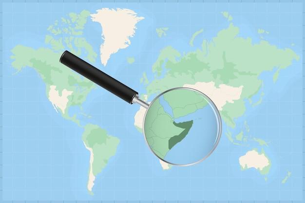 Mappa del mondo con una lente di ingrandimento su una mappa della somalia.