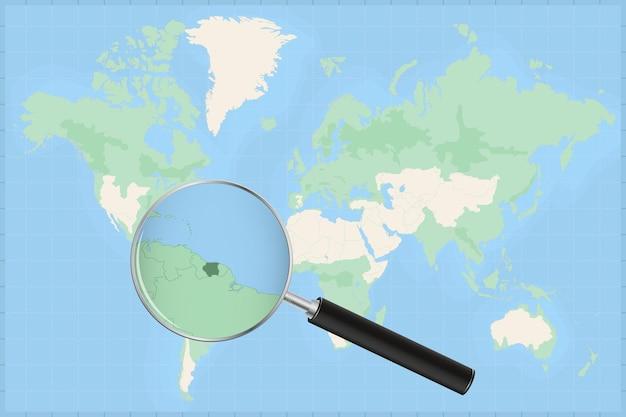 Mappa del mondo con una lente di ingrandimento su una mappa del suriname.