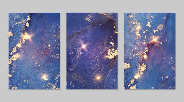 Set in marmo di sfondi astratti blu navy e oro con glitter nella tecnica dell'inchiostro ad alcool