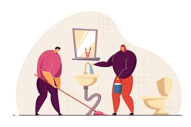 Coppia sposata che pulisce il bagno insieme
