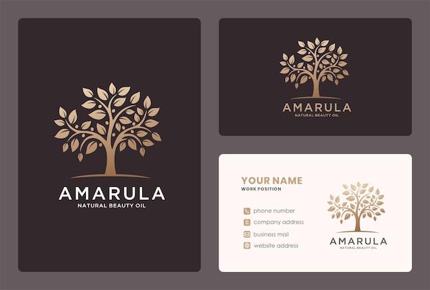 Disegno del logo dell'albero o del ramo di marula in un colore dorato.