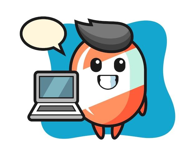 Illustrazione della mascotte della caramella con un computer portatile
