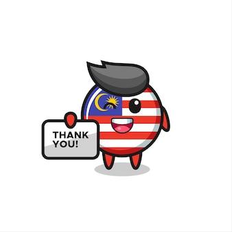 La mascotte del distintivo della bandiera della malesia con in mano uno striscione che dice grazie, un design in stile carino per maglietta, adesivo, elemento logo