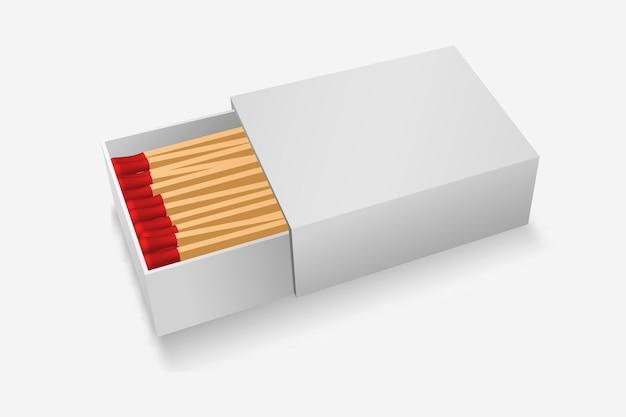 Modello scatola di fiammiferi bianco con fiammiferi rossi in legno