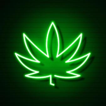 Logo cannabis medica con insegna al neon luminosa foglia di marijuana.