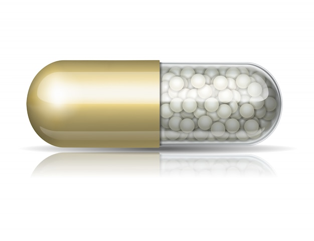 Capsula medica dorata con granuli
