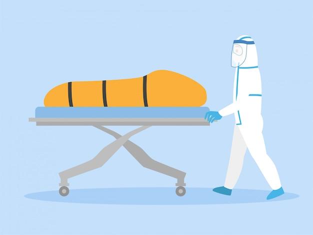 Il personale medico in tuta protettiva personale sposta un cadavere all'interno della borsa