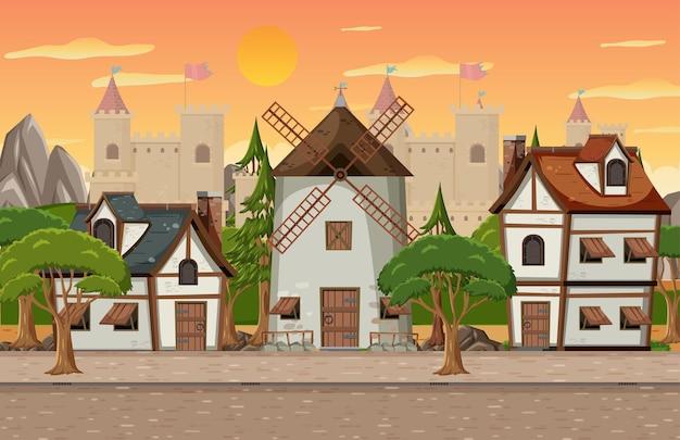 Scena del villaggio medievale con mulino a vento e case