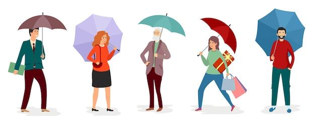 Uomini e ragazze che tengono un ombrello sotto la pioggia