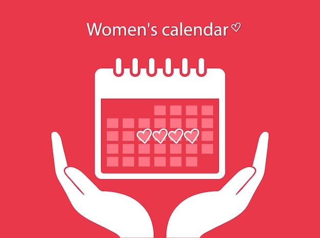 Calendario mestruale. calendario femminile. le mani tengono il calendario con il ciclo mestruale.