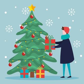 Buon natale ragazzo con albero di pino e regali