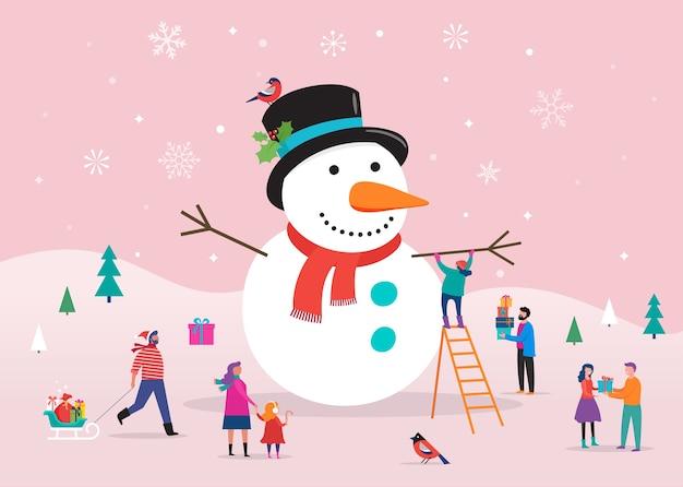 Modello di cartolina di buon natale, sfondo, bannner con enorme pupazzo di neve e piccole persone, giovani uomini e donne, famiglie che si divertono nella neve