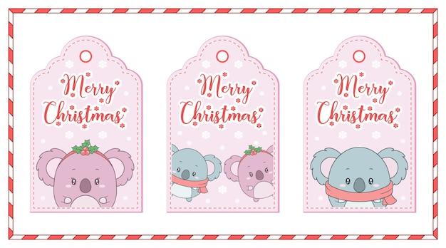 Simpatici animali di buon natale che disegnano cartellini con cornice di fiocchi di neve e caramelle