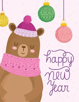 Buon natale, simpatico orso con sciarpa e palline, illustrazione vettoriale di testo disegnato a mano