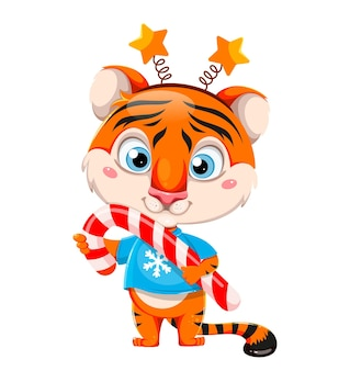 Buon natale simpatico personaggio dei cartoni animati tigre che tiene in mano un grande bastoncino di zucchero